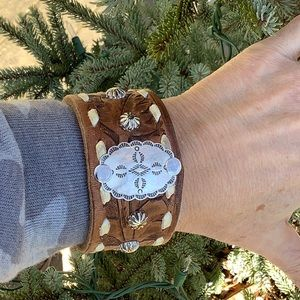 Leather cuff , sterling concho